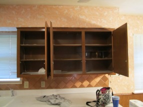 kitchen cabinets - contact paper peeling up already & hooks on the shelves